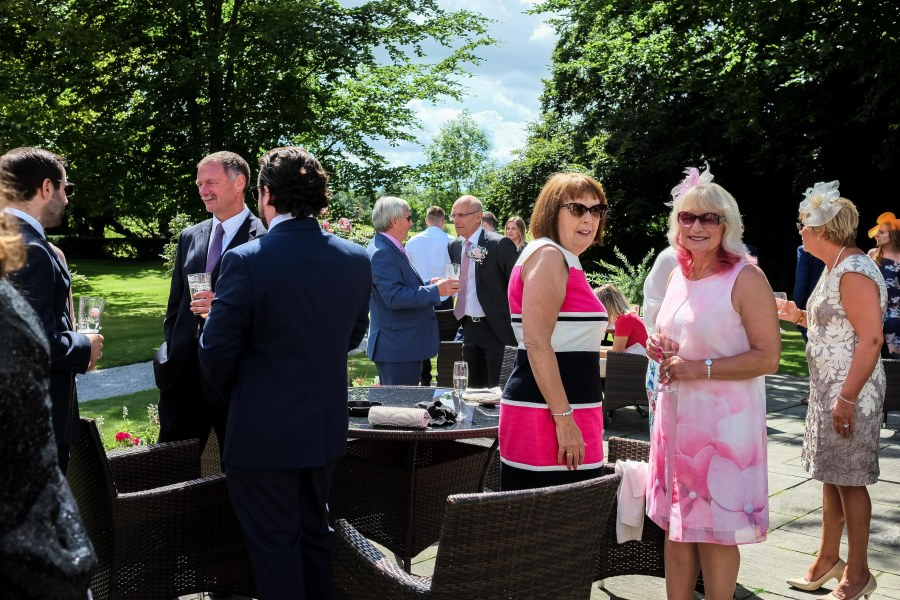 Statham Lodge Wedding - guests enjoying the sunshine.