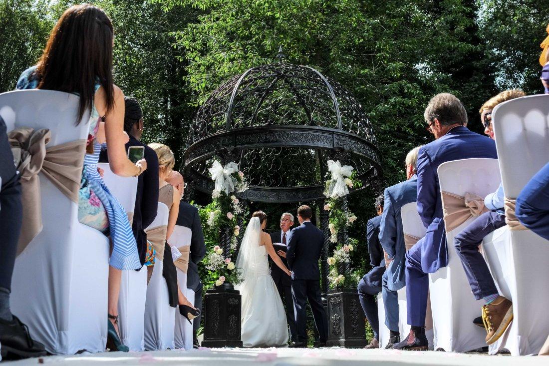 Statham Lodge Wedding - Wedding ceremony and the sun is shining.