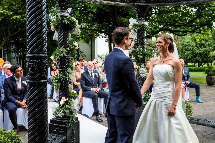 Statham Lodge Wedding - Liz & Steve holding hands