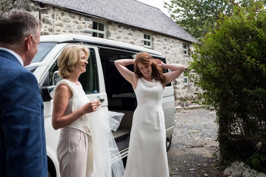 Bride arriving in VW camper at Penarth Fawr wedding.