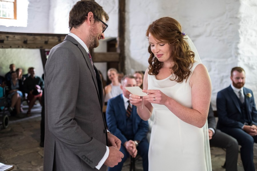 Jess reading out her vows at Penarth Fawr wedding.