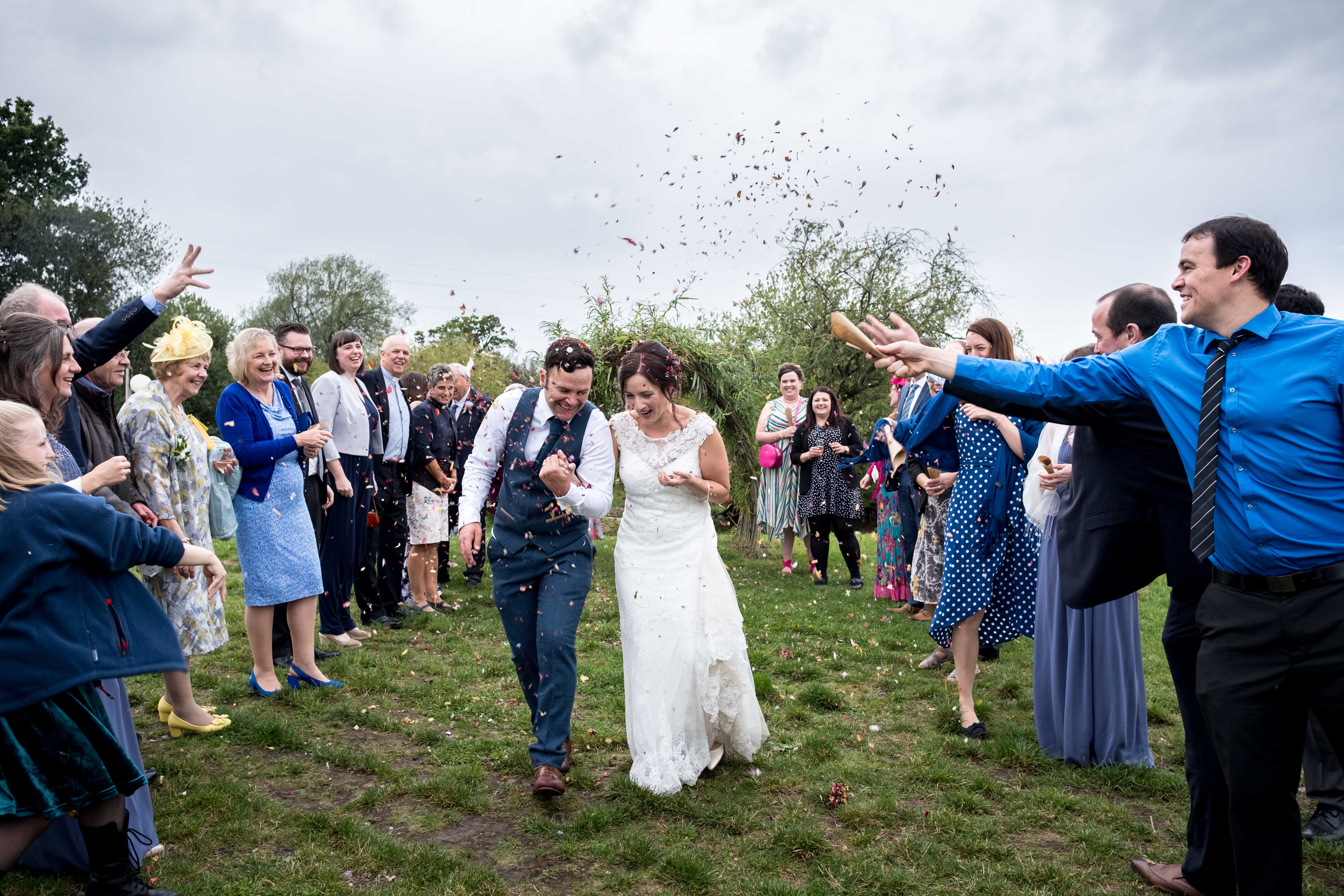 Chester wedding Photographer. Confetti being thrown at a Chester wedding - Photographer is Maurice Roberts