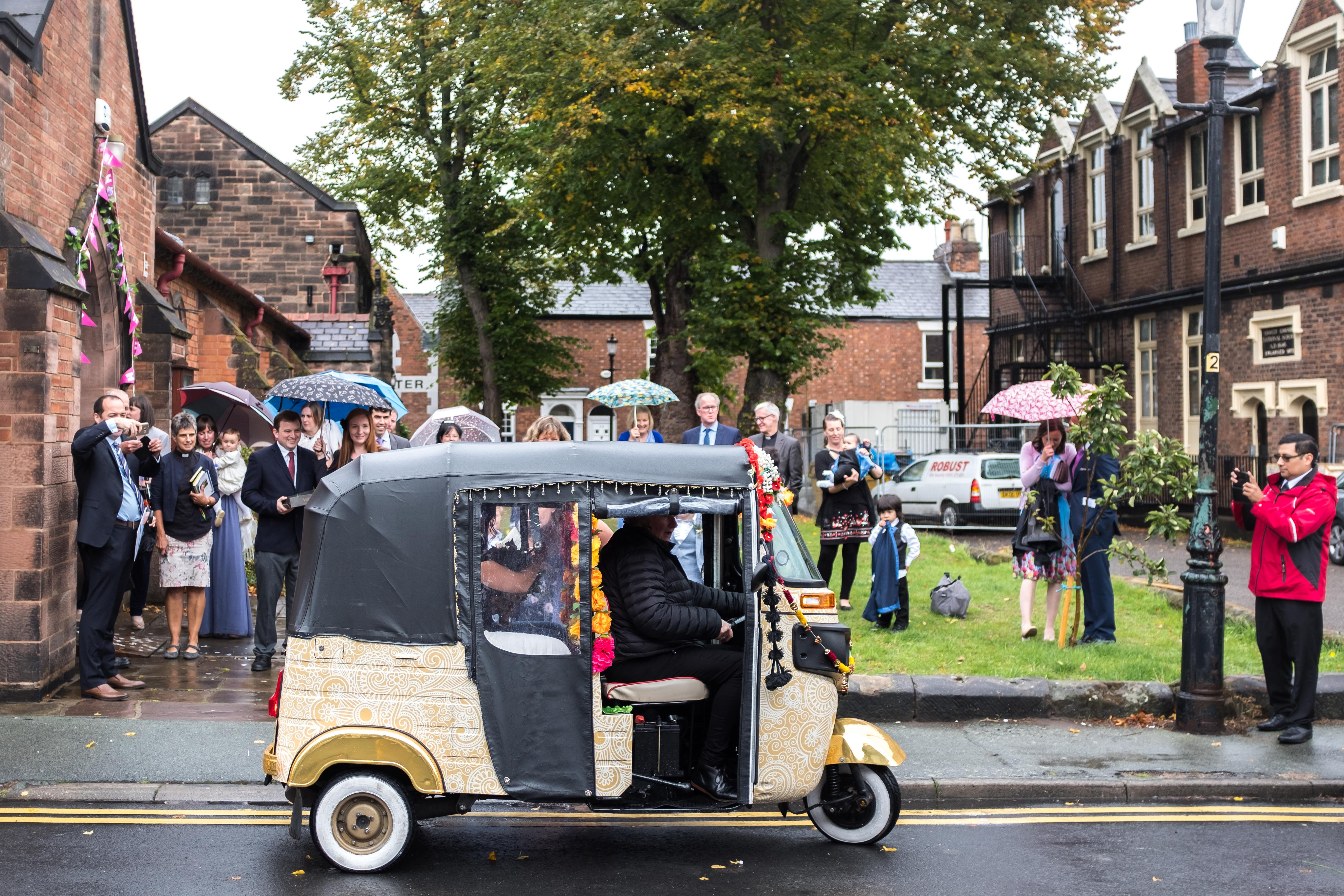 The wedding car arrives to pick up the bride and groom at All Saints church in Chester