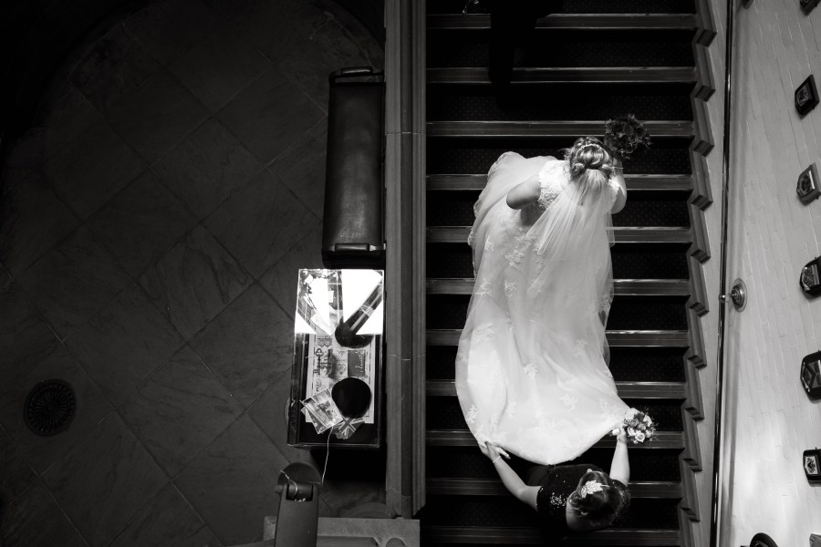 Bride walking up the stairs at Cheshire Town Hall