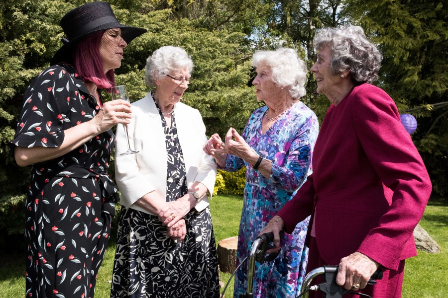 A group of lady's chatting away at a wedding reception in Ruthin North Wales.