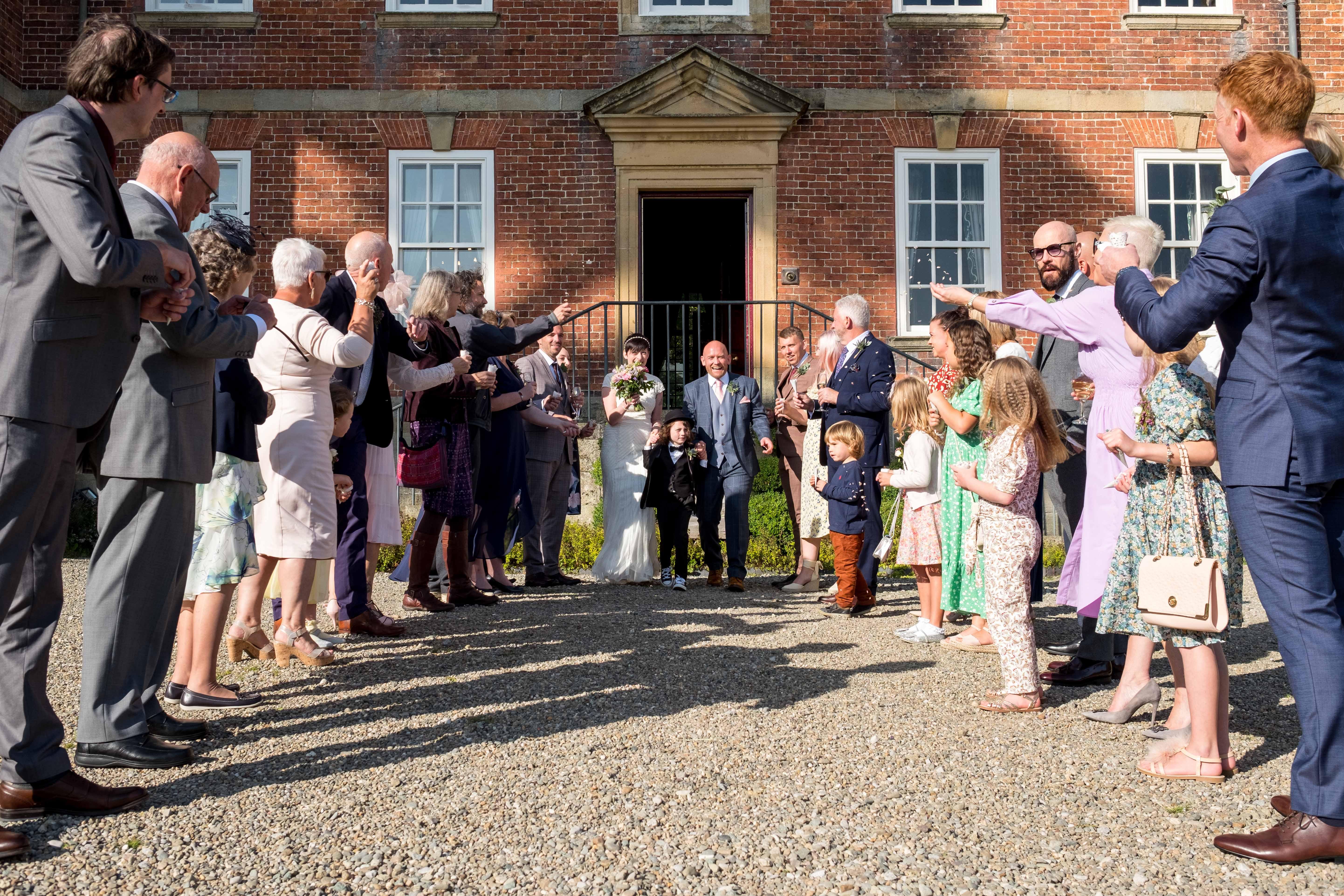 Confetti throw at Trevor Hall wedding Llangollen