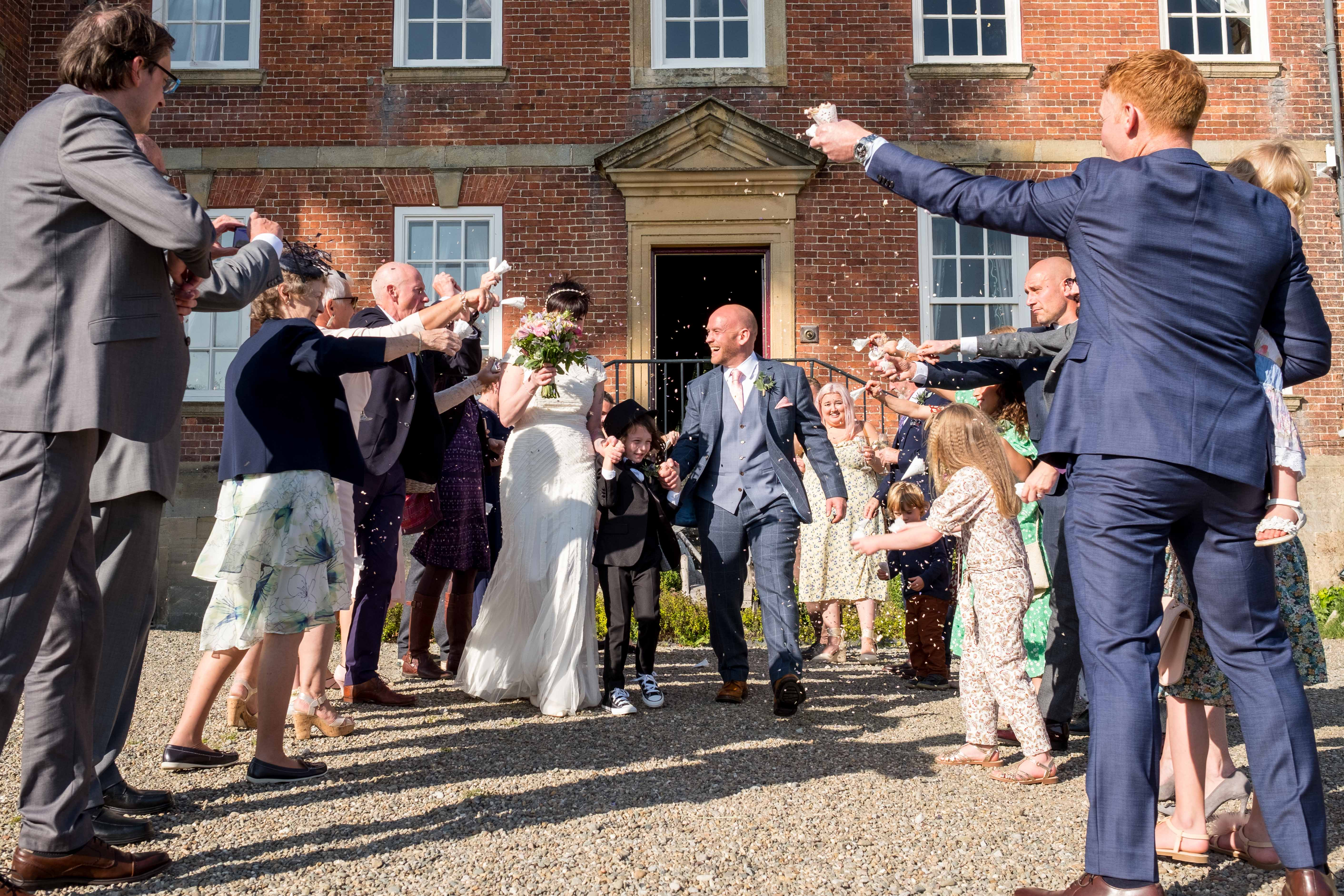Confetti throwing line at Trevor Hall wedding in Llangollen.