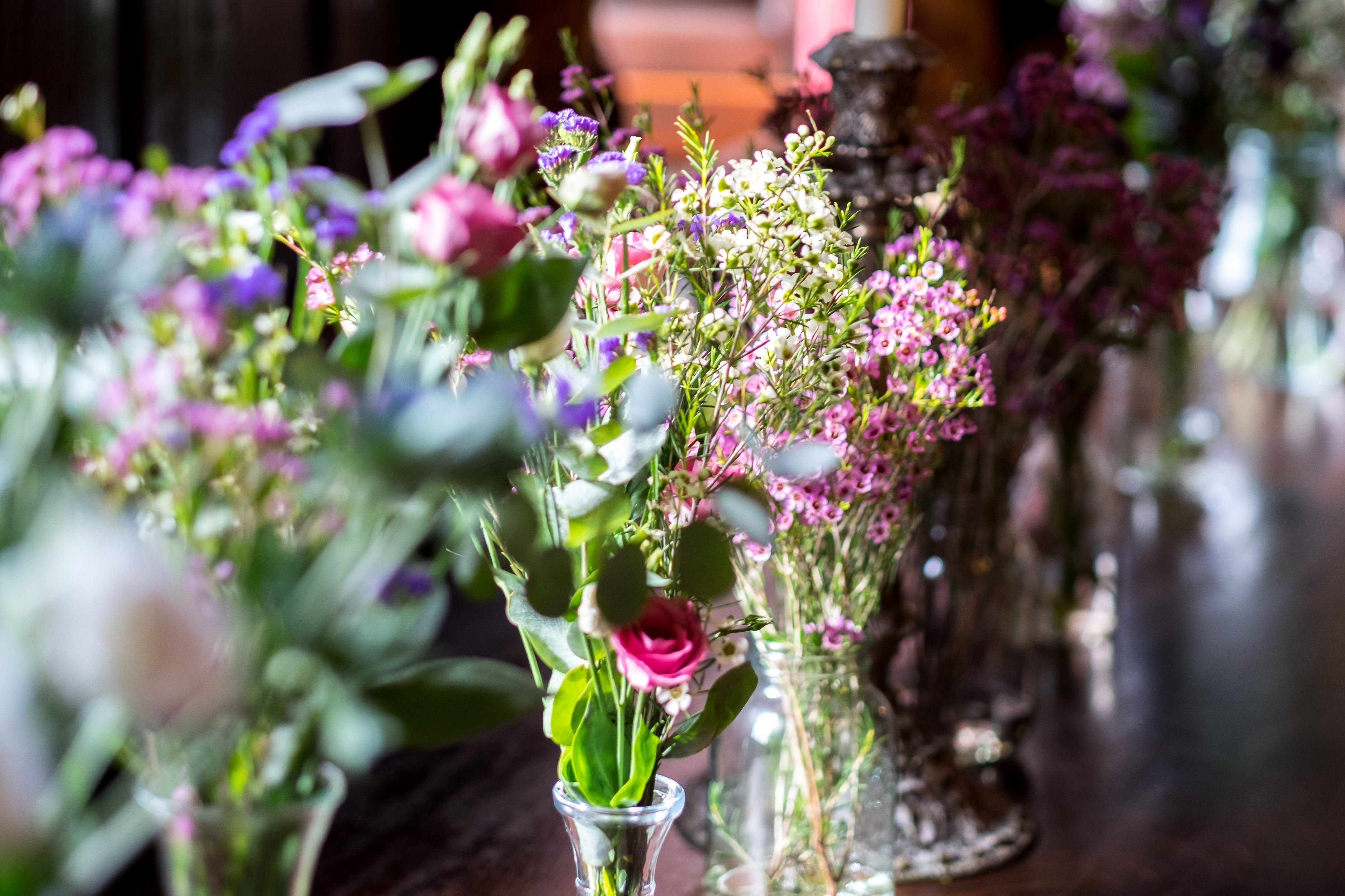 Flowers in vases for the wedding breakfast tables.