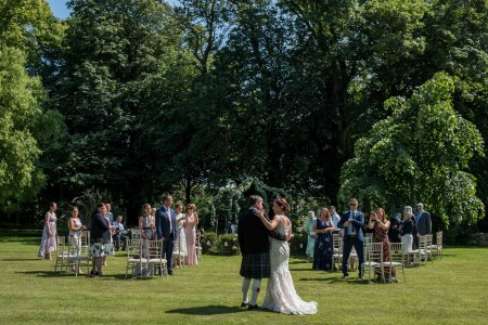 Plas Dinas wedding ceremony with guests clapping and congratulating