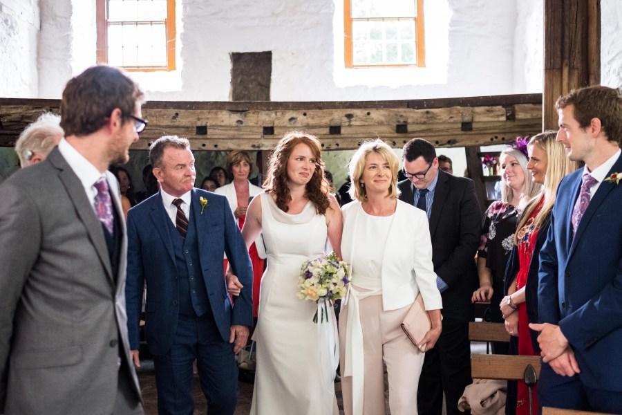 Bride walking up the aisle at a Penarth Fawr wedding