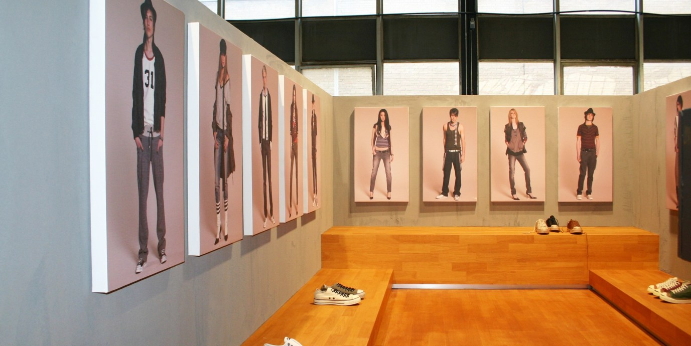 Converse brand stand at fashion fair with wooden benches, product displays and POS material
