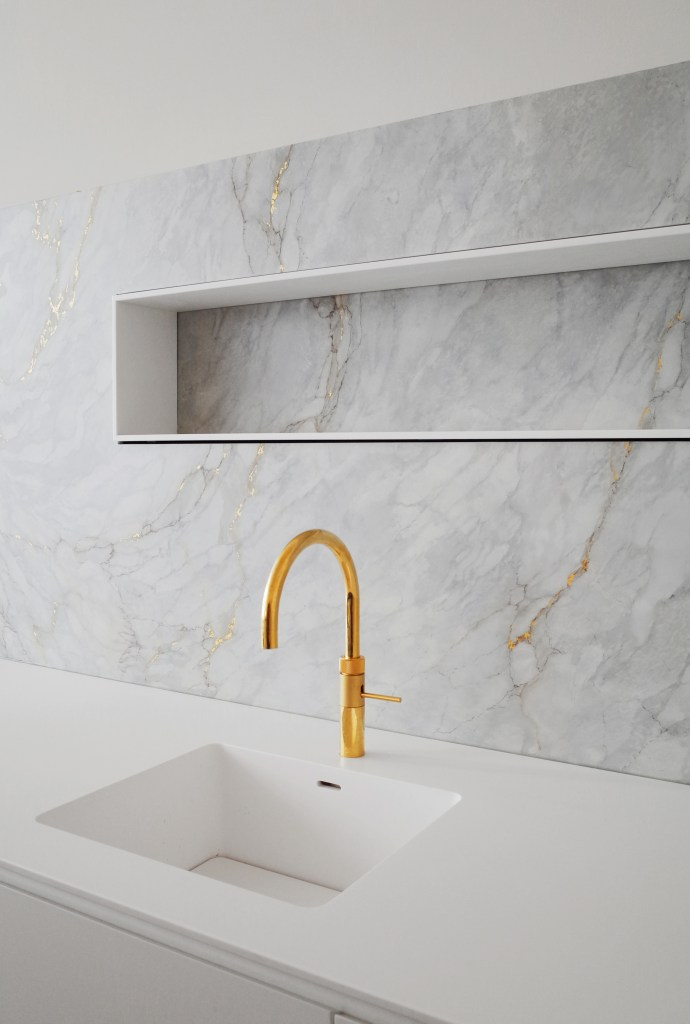 Marble custom architectural kitchen design with gold limited edition Cooker