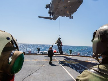 Flight crew lowered from a CH-148 Cyclone to flight deck of HMCS Montreal (Photo: Leading Seaman Dan Bard, Formation Imaging Services)
