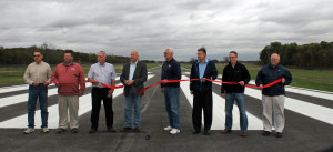 Plymouth officials cut the ribbon to dedicate the widened airport runway.