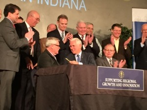 Indiana Governor Mike Pence gifts signing pen to State Senator Jim Arnold following Regional Cities bill signing
