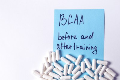 sport nutrition, supplements - bcaa in capsules and guide for it on the white background