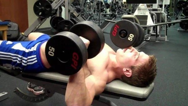 The Dumbbell Bench Press is a great exercise, but you need to take care to do it correctly.