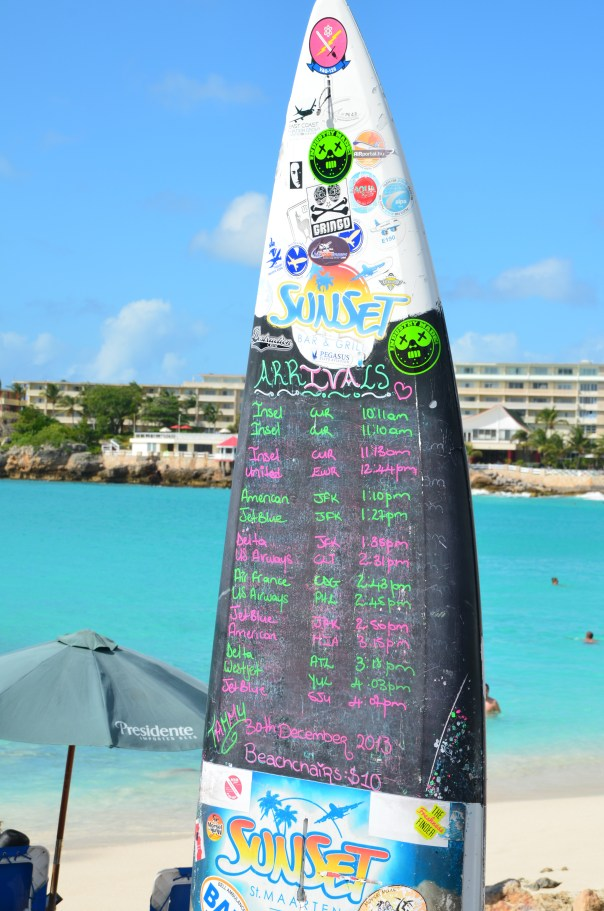 Flight schedule at the popular Sunset Bar on Maho Beach.