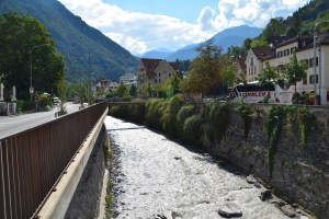 the Rhine river in Chur, Switzerland's oldest city, first founded by Romans in the 1st century BC.