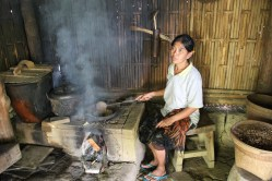 A woman roasting coffee beans