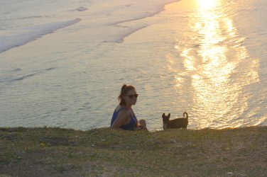 Watching the sunset on a hill with an adorable stray puppy