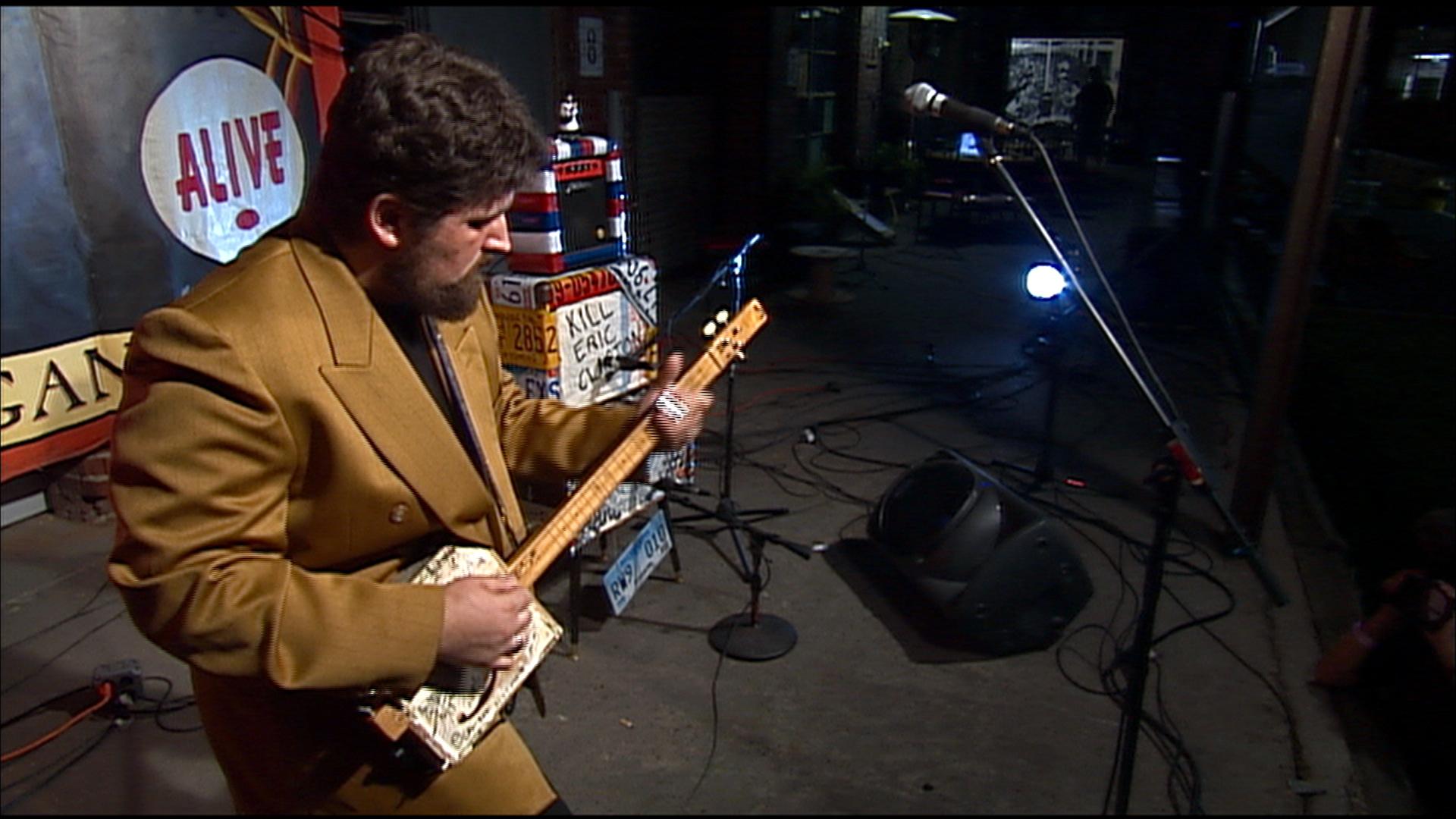 Shane Speal plays a cigar box guitar in Huntsville, Alabama