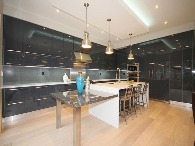 Pure white caesarstone kitchen and graffite marble island