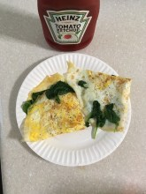 Breakfast: Three egg omelette with spinach and ketchup.