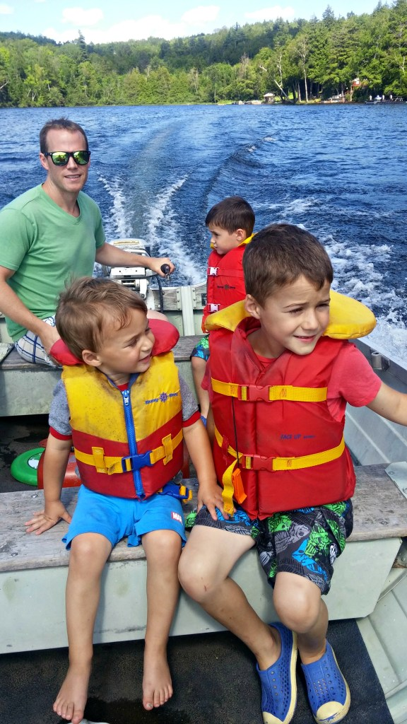 boys and John on boat
