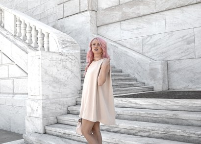 If you love simplicity but with attention to detail, then you'll want to slip into this must-have open back cape dress. I'm swooning over this piece!