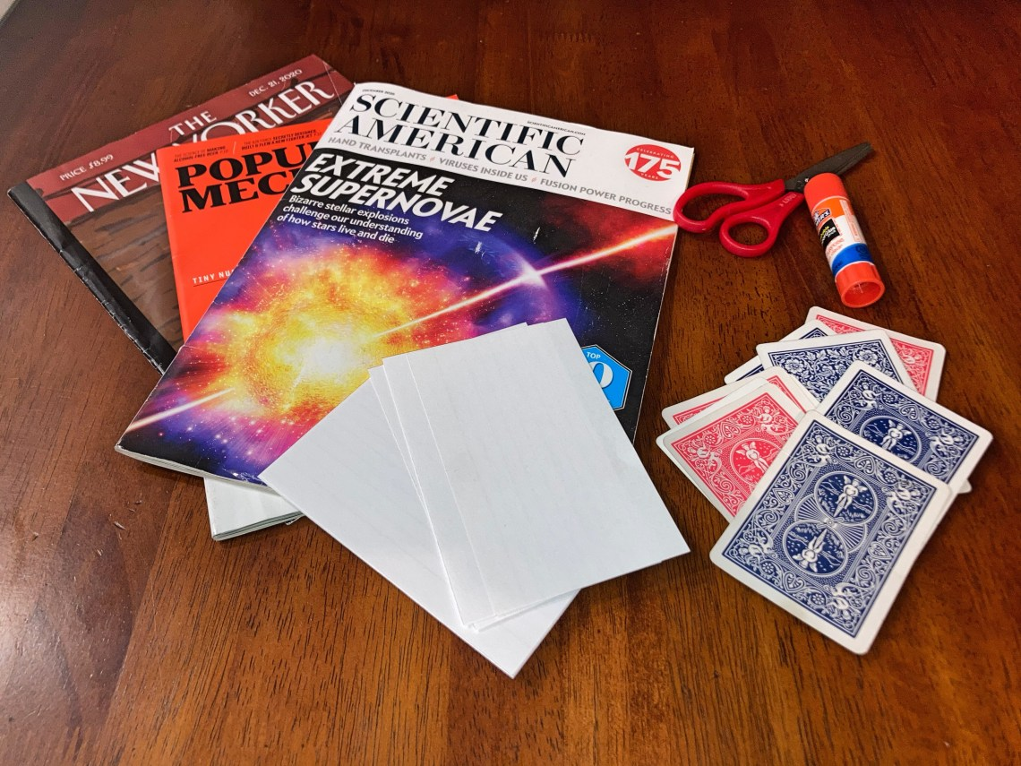 Pile of magazines, playing cards, glue and index cards