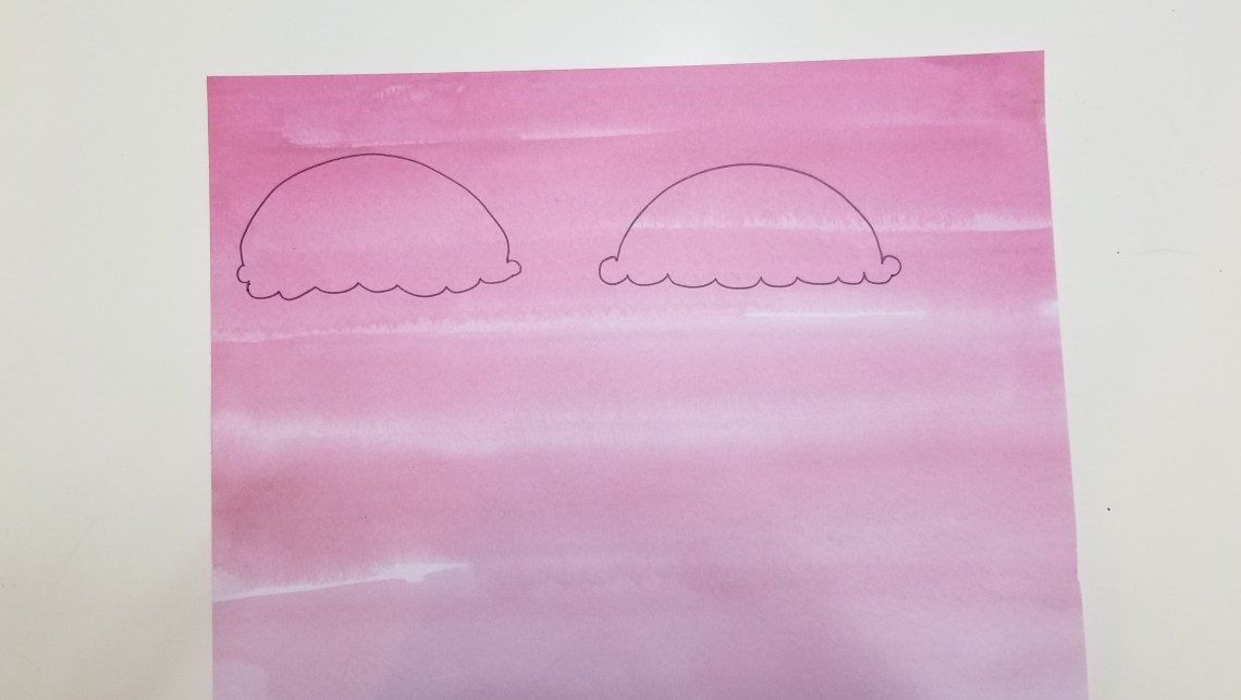 Two ice cream scoops drawn on pink paper