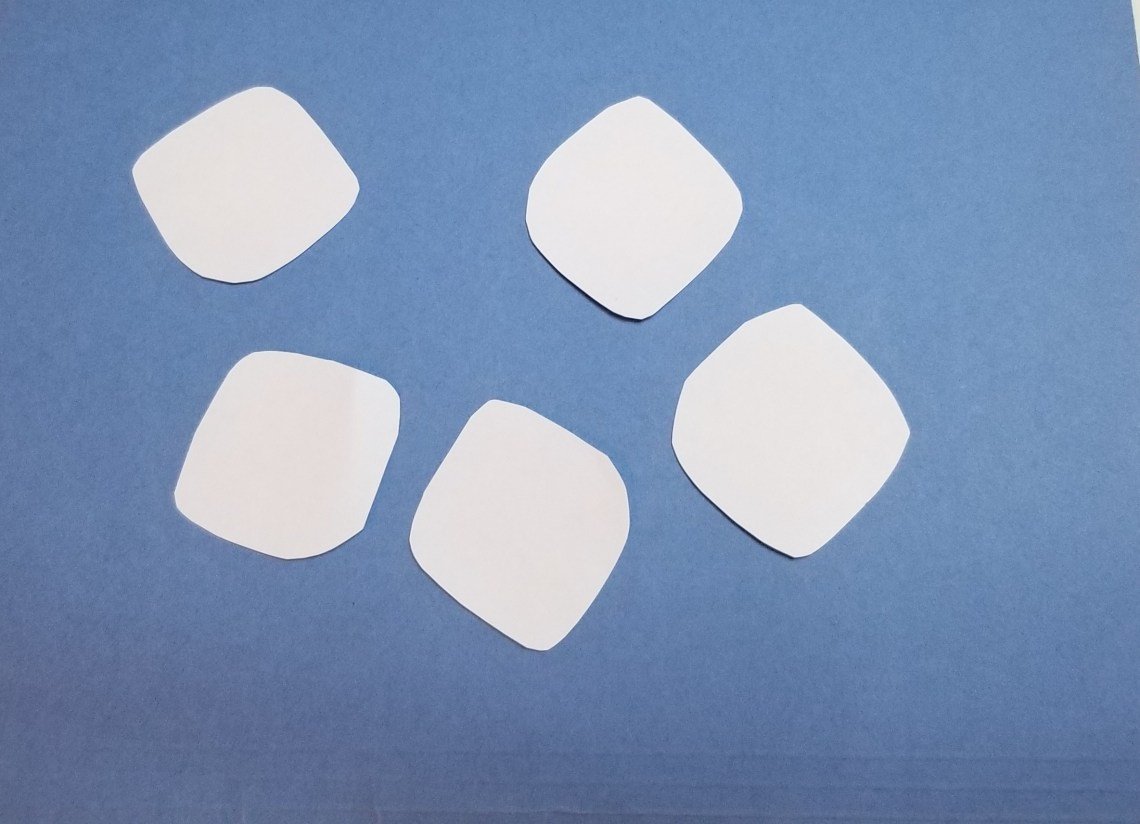 pretend marshmallows cut out of white paper