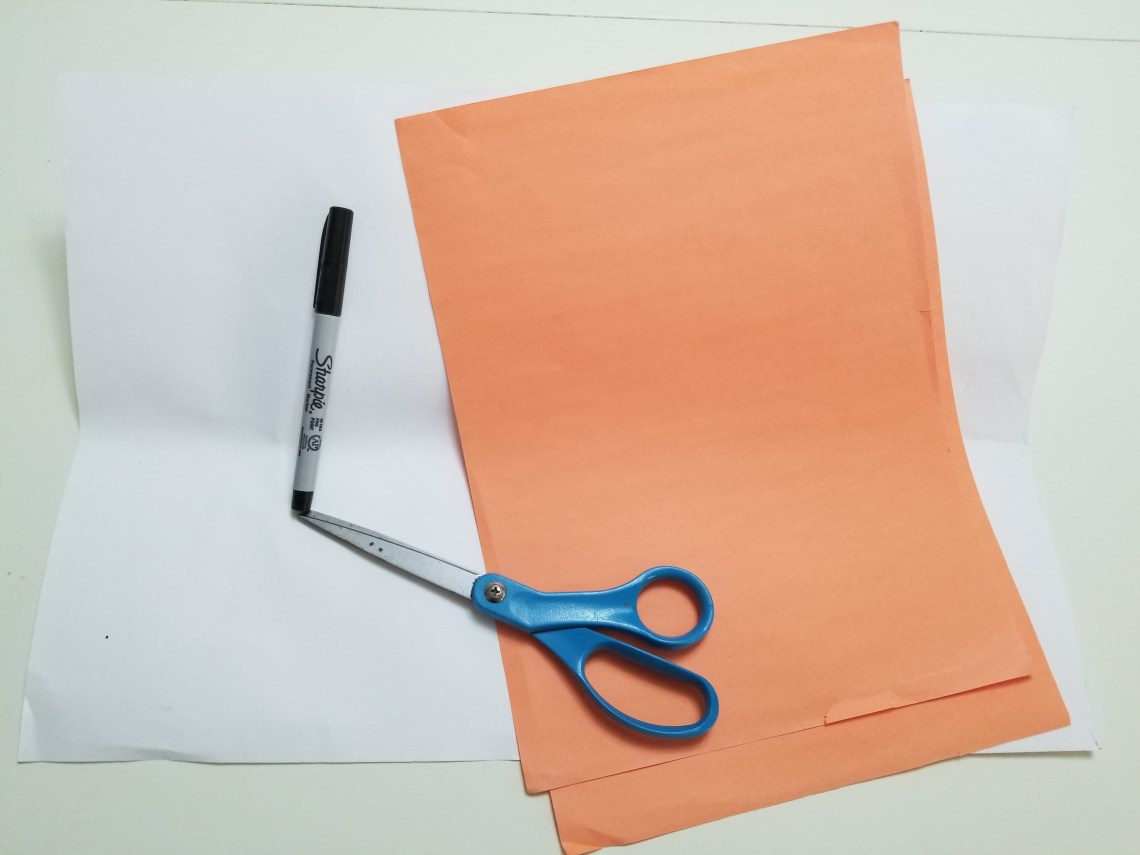 Orange and white paper, scissors, Sharpie