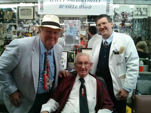 Kenneth 'Otis' Junkin and Allan 'Floyd' Newsome help celebrate Russell's 90th birthday.