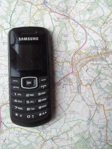 Image of mobile phone on top of map