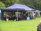 The Osmaston Band trying to keep dry, yet able to blast out some great music