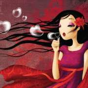 girl with long hair blowing heart