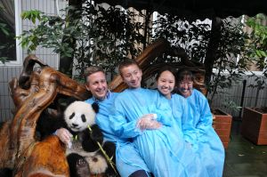the family with a baby panda!