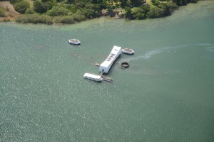 view of the USS Arizona at Pearl Harbor (oil is still leaking from the ship)