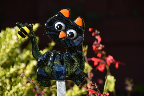 Fused glass black cat with bee on tail garden art