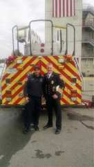 Firefighter Matthew James (left) at his graduation from the recruit academy.