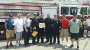 James McGown and Derek Maskalenko (center) at graduation with other members of Maynard Fire.
