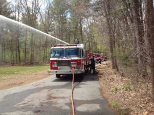 Firefighters conducting pump training.