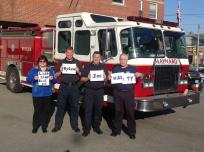 (Left to right) Nancy Brooks, Administrative Assistant, Firefighters Dan Gould and Jack Primiano, and Captain Tim Gray showing their support for autism.