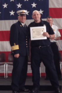 Firefighter Shawn Boulette (right) at graduation with Chief Anthony Stowers.