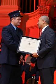 Captain Sean Kiley receiving the Firefighter of the Year Award for Community Service from Governor Deval Patrick in 2014.