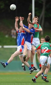 Mayo's Ronan McGarrity rises with two Mayo-born New York players, Dermot Keane from Knockmore (left) and Robert Moran from Foxford. Photo © Mayo News