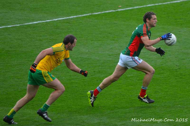 Michael Murphy of Donegal GAA chases Tom Parsons of Mayo GAA