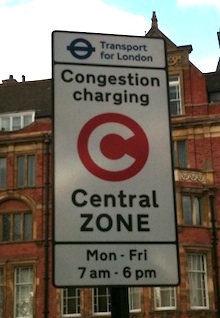 c-charge-sign